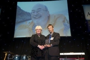 Jenny Keeley accepts the lifetime achievement award for her husband David from OATA's Keith Davenport